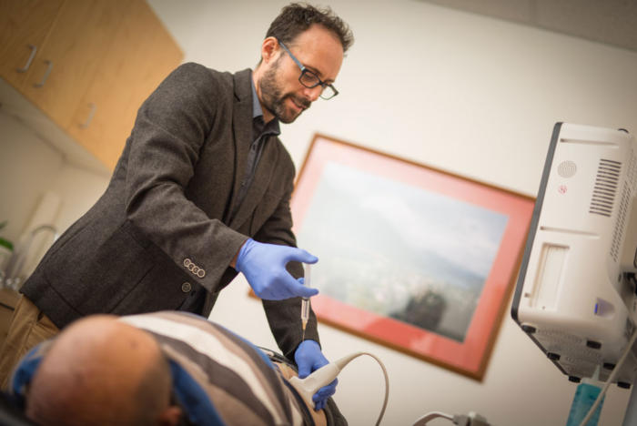 Dr Joel administering prolotherapy